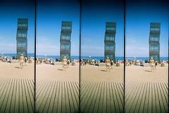 Upright... (Trapac) Tags: barcelona blue sea summer people sculpture film beach water vertical four lomo lomography spain supersampler sand fuji 4 catalonia fujireala plasticfantastic espana installation barceloneta boxes catalunya publicart horn sunbathing reala plasticcamera meditteranean 100iso wmh rebeccahorn omo platjadesantsebastia homenatgealabarceloneta supersamplerroll25 boxtower
