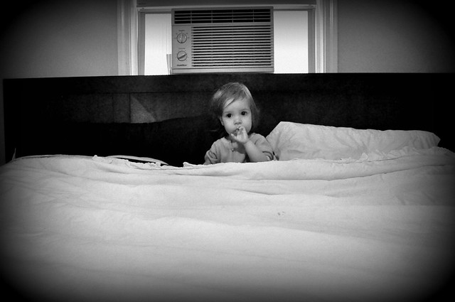 Little Girl in a Big Bed