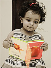 Beneficence in Education begins from the childhood...! (Nourah.A.A }) Tags: red orange baby fish cute apple girl childhood book kid education child read jeje learn begins beneficence
