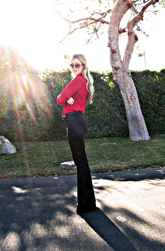 black flared trousers+red sheer blouse+gold accessories+sun+sharp+pf