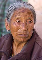 Looking wistful (bag_lady) Tags: portrait woman india female buddhist tibetan mcleodganj himachalpradesh earthasia unseen~india unseen~asia