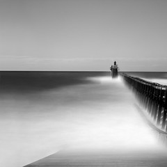 The Lighthouse BW (Michael Diblicek) Tags: longexposure sea blackandwhite lighthouse white black france west pier big movement holidays jetty south gray cap breton southwestfrance capbreton leefilters bigstopper