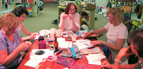 A table of knitters working away!