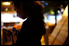 Tap tap (Lefty Jor) Tags: street light hk girl night hair hongkong dof bokeh misu iphone voigtlandernoktonclassic3514sc nex3