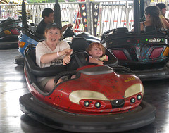 Mom with crazed look and Speck hanging on in a bumper car