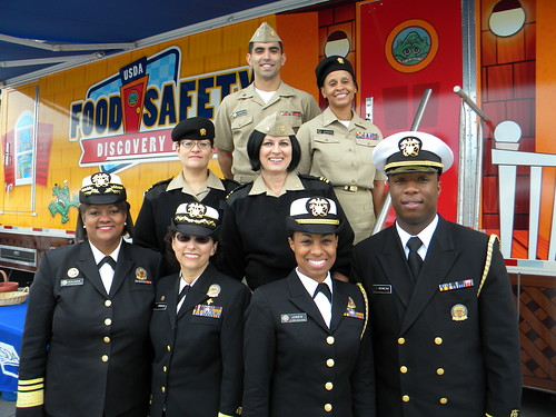 The Food Safety Discovery Zone's hardworking staff of U.S. Public Health Service Commissioned Corps Officers take a break to pose with Surgeon General Regina Benjamin outside of the exhibit.The Food Safety Discovery Zone's hardworking staff of U.S. Public Health Service Commissioned Corps Officers take a break to pose with Surgeon General Regina Benjamin outside of the exhibit.