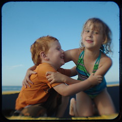 Raft kids (Area Bridges) Tags: blue sky beach lucy pentax kodak connecticut july bluesky trampoline raft milford dexter dex duaflex skyblue 2010 duaflexiv kodakduaflexiv ttv throughtheviewfinder july2010 k200d areabridges