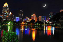 Lumpini Park Lights (MikeBehnken) Tags: longexposure moon thailand asia southeastasia cityscape bangkok crescentmoon waterreflections lumpinipark cityskylines glasswater bangkokthailand nightreflections wetreflections beautifulcity asiaatnight colorfulreflections asiabynight flickraward lovelycity unseenasia lumpiniparkbangkok beautifulbangkok totallythailand bangkokparks waterreflectionsatnight dwcffcolorful