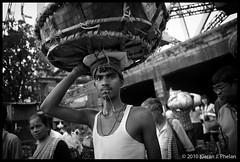 Kolkata Coolie (Phelo) Tags: street india flower work market working worker kieran kolkata 2009 calcutta phelan phelo