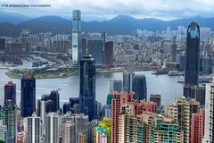 """A Tale of Two Skylines"" (TIA International Photography) Tags: china city trees summer urban panorama mountains building tower home ferry skyline architecture skyscraper port marina tia real boats hongkong hotel harbor office dock cosmopolitan asia day commerce cityscape estate view apartment pacific metro cloudy harbour district centre ships central peak bank overcast august landmark center victoria terminal east neighborhood hills jordan condo vista metropolis daytime capitalism residence sprawl kowloon region icc ifc shrubs investment tsimshatsui condominium density cradle finance vicinity urbanity tosinarasi tiascapes tiainternationalphotography"