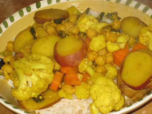 Curried chick peas, potatoes, and cauliflower over rice