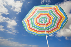 Beach Parasol (Alex Bramwell) Tags: summer vacation holiday beach vertical clouds colorful sunny bluesky parasol