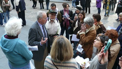 The tour stops at Federal Hall, Wall Street