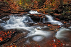 roundabout ([Adam Baker]) Tags: park autumn red orange nature water yellow rock canon waterfall leaf state pennsylvania falls glen pa flowing cascade ricketts 5dmarkii