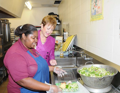 FNCS Deputy Under Secretary Dr. Janey Thornton watches as Chasity Fondren, prepares a salad for lunch at Pope Elementary/Junior High School, Pope, Miss.  The school received a HealthierUS School Challenge Bronze Award on Nov 3.