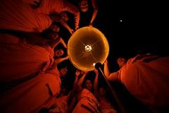 Monks preparing a Floating Lantern (khom loi) for the Yi Ping festival i Chiang Mai, Thailand (Ephemeris888 (Studiof8)) Tags: orange thailand southeastasia floating monk chiangmai lantern khomloi flickraward flickraward5 flickrawardgallery