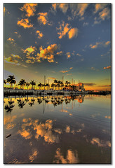 November Sunset at The Twin Dolphin (tebographics) Tags: sunset cloud reflections florida palmtree hdr bradenton cloudscapes twindolphin manateeriver