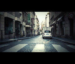 streets of paris (millan p. rible) Tags: street cinema paris france canon movie still cinematic bleachbypass canonef50mmf14usm streetsofparis canoneos5dmarkii 5d2