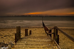Stepping Out (jakeof) Tags: uk sunset beach sussex waves groyne breakwater easthead