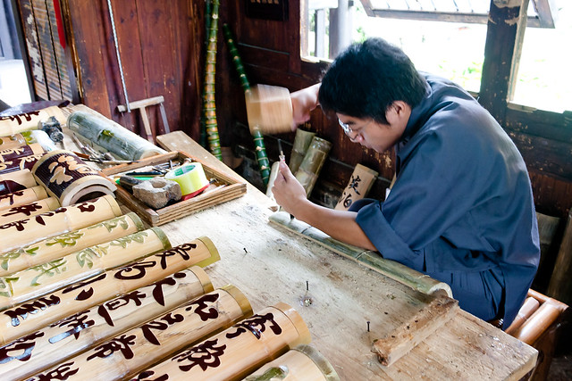 Carving characters onto bamboo