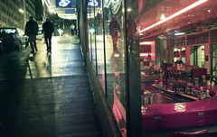 Zebra effect (sparth) Tags: seattle leica november red reflection bar night dark walking washington downtown silhouettes curb trottoir x1 2010 downtownseattle seattledowntown leicax1