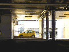 A Yellow Fellow (Steve Taylor (Photography)) Tags: support column pipes slope architecture fence building yellow white black metal concrete newzealand nz southisland canterbury christchurch cbd city vehicle car automobile auto