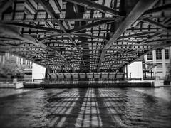 Under the Bridge - Chicago Illinois (vwcampin) Tags: iphoneography iphoneographer iphoneology iphonology ibeams downtown shadow water beams steel trusses bridgegrates steelbridge chicagoriver river chicago angles lines bridge blackandwhite