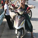 Uyghur woman and moped - Kashgar