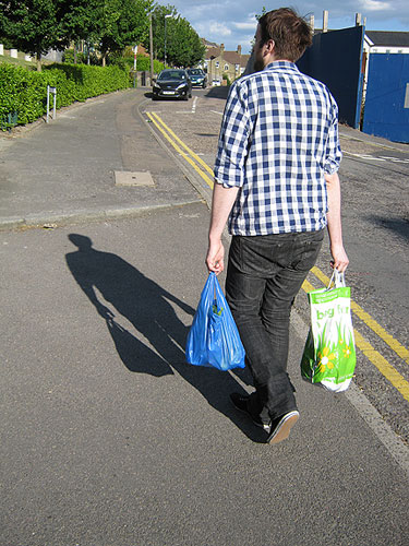 carl carrying the shopping home