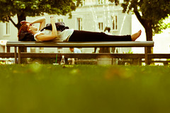 Streetlife: Woman lying on a park bench (yago1.com) Tags: park city portrait people urban woman green girl canon bench switzerland sommer chilling stadt rest zuerich freizeit leben 2010 eos7d yago1