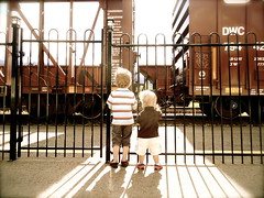 boys|trains (DJHuber) Tags: railroad family canada boys station cn train fence cafe gallery bc marcus platform tracks rail railway columbia canadian stop national british elijah whistle mcbride whistlestop