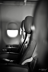 Pray that your loneliness may spur you into finding something to live for, great enough to die for - Dag Hammarskjold (Sarah Al-Sayegh Photography | www.salsayegh.com) Tags: bw plane airplane nikon aljazeera empty air flight seats airbus airways a320 emptyseats nikond700 d7000