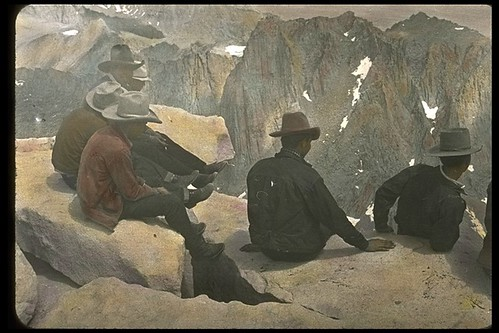 Packers enjoying the view from the top of Mt. Whitney, 1932. Hand tinted photograph.