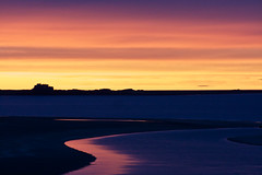 Lindisfarne. (Ian McWilliams.) Tags: blue sunset red sea sky orange water yellow river island purple dusk bamburgh holyisland lindisfarne lindisfarnecastle budlebay areaofoutstandingnaturalbeauty georgethebotter