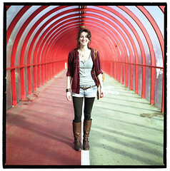 Kirsty in the Tunnel (2plus2isfive) Tags: red portrait green girl lines shirt architecture zeiss scotland clyde vanishingpoint arch boots geometry path glasgow perspective tunnel symmetry hasselblad denim shorts middle secc portra kirsty exhibitioncentre checked 500cm armidillo tetenal colortec sartorialist hip2bsquare autaut