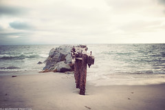 Battered repeatedly by the crashing waves.... (dj murdok photos) Tags: ocean wood old longexposure summer urban nature vintage outdoors losangeles rocks waves bokeh empty sony socal rusted crashing 35g a850 silkywater cz85