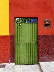 green metal/ bright stucco (msdonnalee) Tags: door wall facade mexico puerta gate lock entrance doorway porta mexique porte fachada locked entry stucco mexiko  lockeddoor colorphotoaward artofimages photosfromsanmigueldeallende bestcapturesaoi fotosdesanmigueldeallende greenmetaldoor