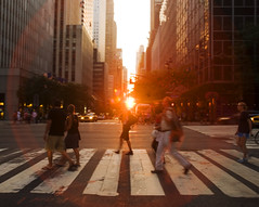manhattanhenge. (Vitaliy P.) Tags: street new york city nyc sunset people sun angel lens nikon crossing manhattan wide 2nd explore flare gothamist burst setting 42nd 2010 manhattanhenge aligned explored d80 vitaliyp