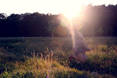 Natural Spotlight (oOTheSmallOneOo) Tags: light sunset portrait sun flower nature girl field evening jump ray meadow spotlight human flare goldenhour