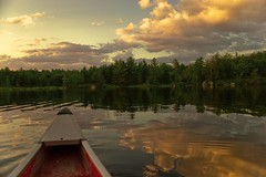 Kawartha Highlands - Best seat on the lake (Dave Noyle) Tags: trees sunset lake ontario canada reflection clouds highlands crab canoe ripples 2010 kawartha