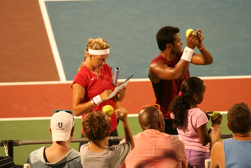 Signing balls after mixed doubles with Victoria Azarenka