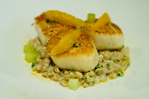 Diver scallops with farro risotto, orange slices, and cucumber, Aldea