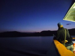 sunrise on the boat (athinaf) Tags: sea black travelling water sunrise dark boat hugging couple aegean greece volcanic cuddling cyclades cycladic