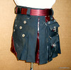 Distressed Black Mini- Kilt with oxblood leather accents.