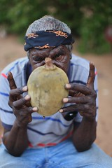 IT070710_MG_5144 Showing a boab nut (ingetje tadros) Tags: travel family portrait people man art smile face hat station canon dark bush eyes hands community cowboy different desert cattle candid traditional culture australia tribal carving single tribes wa outback remote nut tradition aboriginal westernaustralia broome indigenous cablebeach boab theoutback stockmen worldportraits indeginous ingetjetadros indigenousaustraliawathe outbackbushremotebroomedesertcommunitythe kimberleychildsingleyoungtribesindeginouscable beachculturetraditionalozdampier peninsulaoff roadportraitfacepeoplefamilyportrai