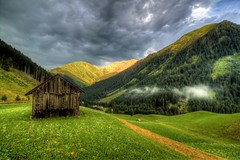 Alpine Storm - Berwang, Austria (To Uncertainty And Beyond) Tags: sunset sky mountains alps grass clouds bavaria austria village roadtrip tyrol hrd austrianalps romanticroad rollingmountains berwang mountainhdr tyrolalps tirolalps tirolmountains berwangaustria