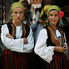 Serbian National Dress from Pirot. Tanjica Perovic Photography. (Tanjica Perovic) Tags: portrait nationalcostume girls serbian serbia pirot narodnanosnja tradition folklore dress headdress moods folk smile opposites look looking beautiful personalities character lace contrasting contrast srbija pirotsrbija pirotski pirotserbia twooppositecharacters groupportrait seriousvslovely reservedvssmiling personality contrastingexpressions boredvsenthusiastic sigma1770mmf2845dcmacro tanjicaperovicphotography canoneos400d fotografijepirota folklor pirotskanosnja шамија throughherlens