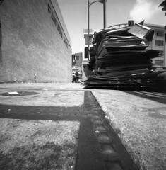 Fantasia Sales (QsySue) Tags: city blackandwhite building sign wall losangeles downtown 120film sidewalk boxes pinholecamera zero2000 zeroimage toydistrict expiredfilm developedathome agfafilm handmadecamera reallyoldfilm zeroimage2000 losangelesst 120camera isopaniss like30yearsold fantasiasales butnotmadebyme