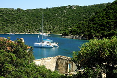 At anchor in Porto Leone (antonioVi (Antonio Vidigal)) Tags: canon island earthquake sigma greece catamaran 1770 anchored abandonedvillage kalamos portleone happyisland portoleone 40d atanchor antoniovidigal antoniovi kefali