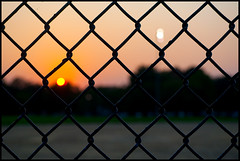 Horner Park (Andy Marfia) Tags: sunset chicago fence iso200 bokeh f8 baseballdiamond d90 northcenter 55200mm parklight hornerpark 1250sec